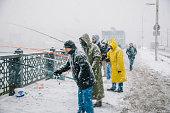 Fishing at Galata Bridge at winter time, Istanbul