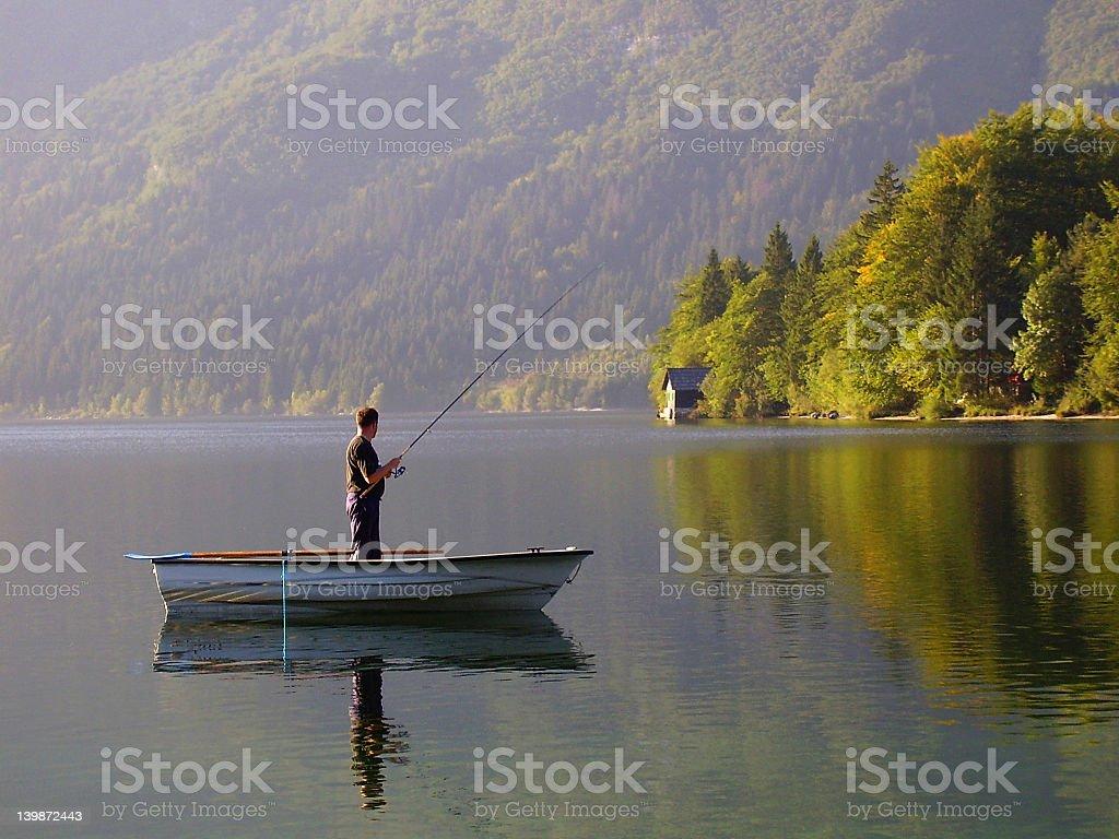 Fishing at Lake Bohinj stock photo