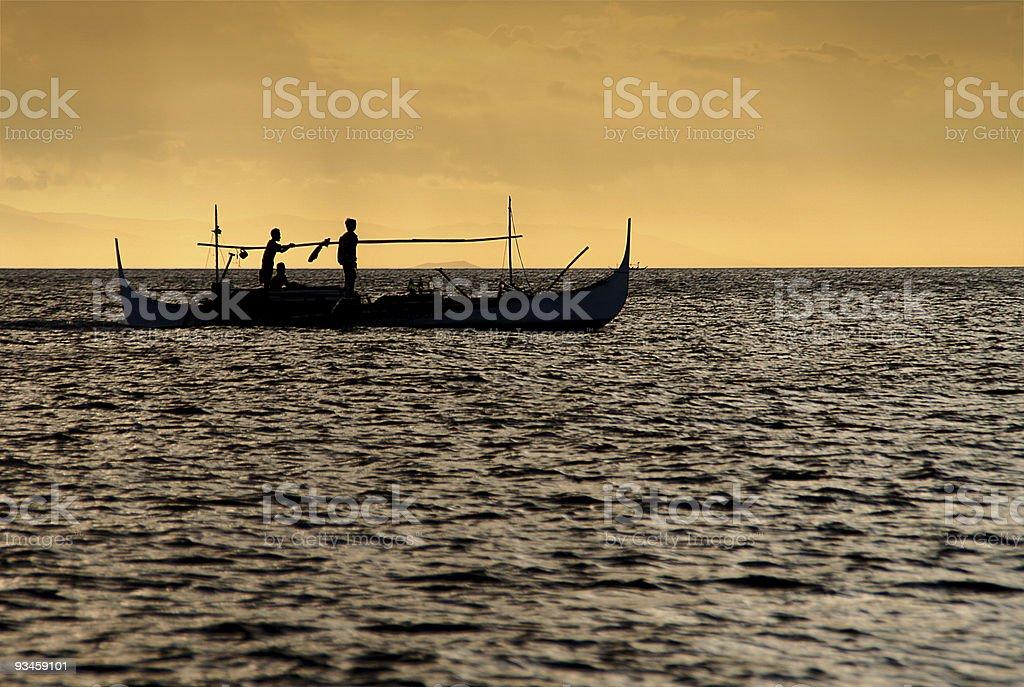 Fishing at sundown stock photo