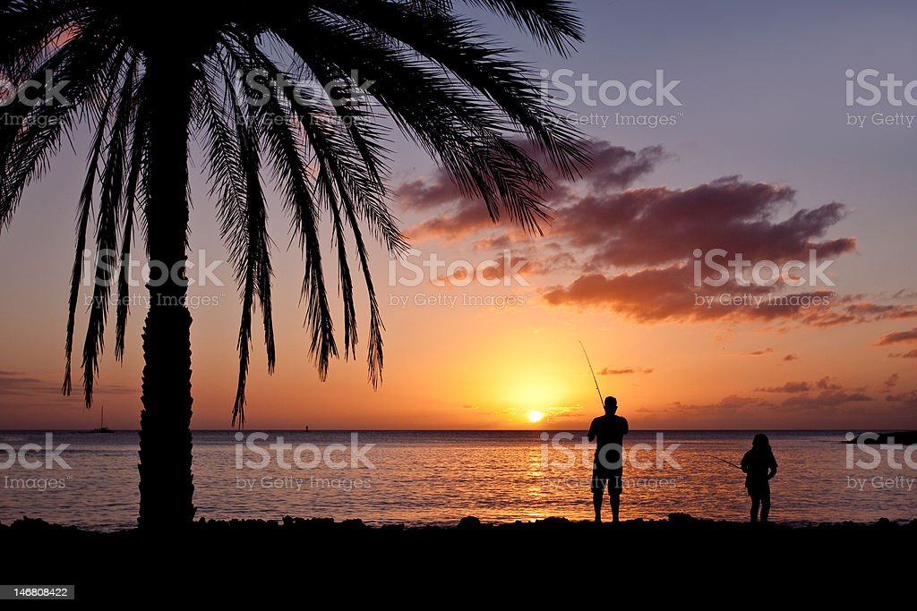 Fishing at sunset in Hawaii royalty-free stock photo