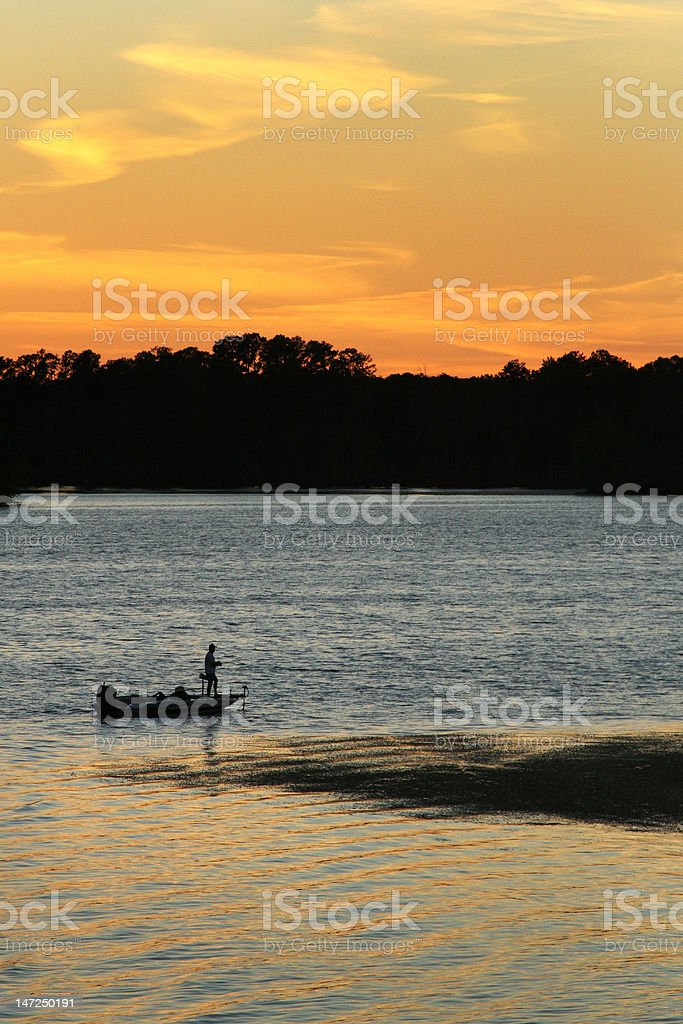 Fishing at Sunset royalty-free stock photo