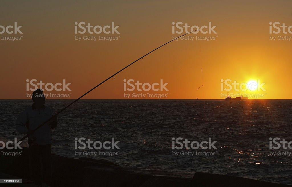 Fishing at Sunset royalty-free stock photo
