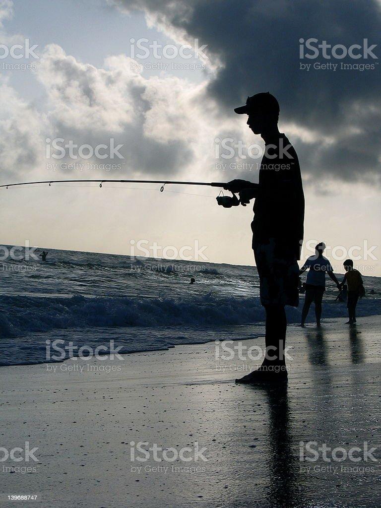 Fishing at the beach royalty-free stock photo