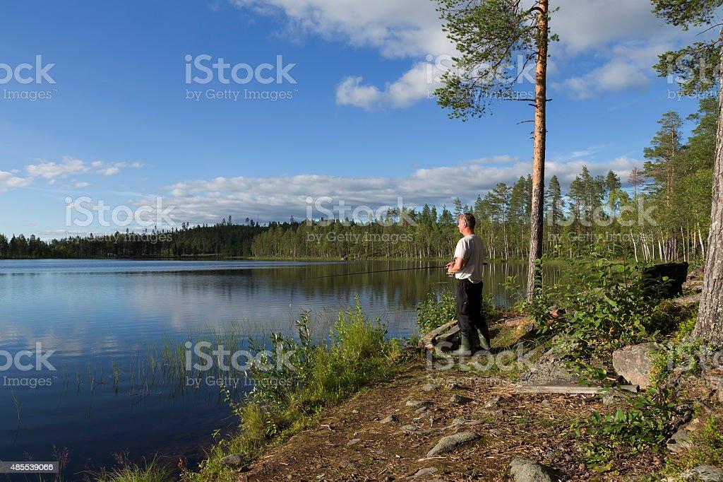 Fishing at the lake royalty-free stock photo