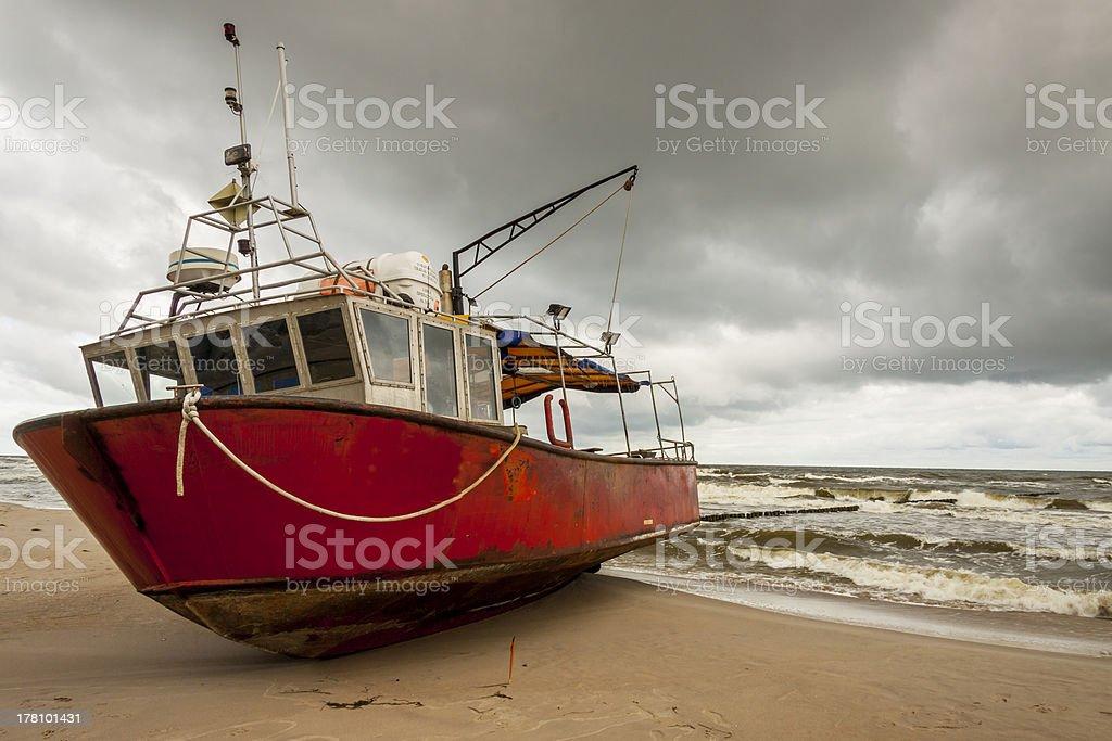 Fishing boast on the beach. stock photo