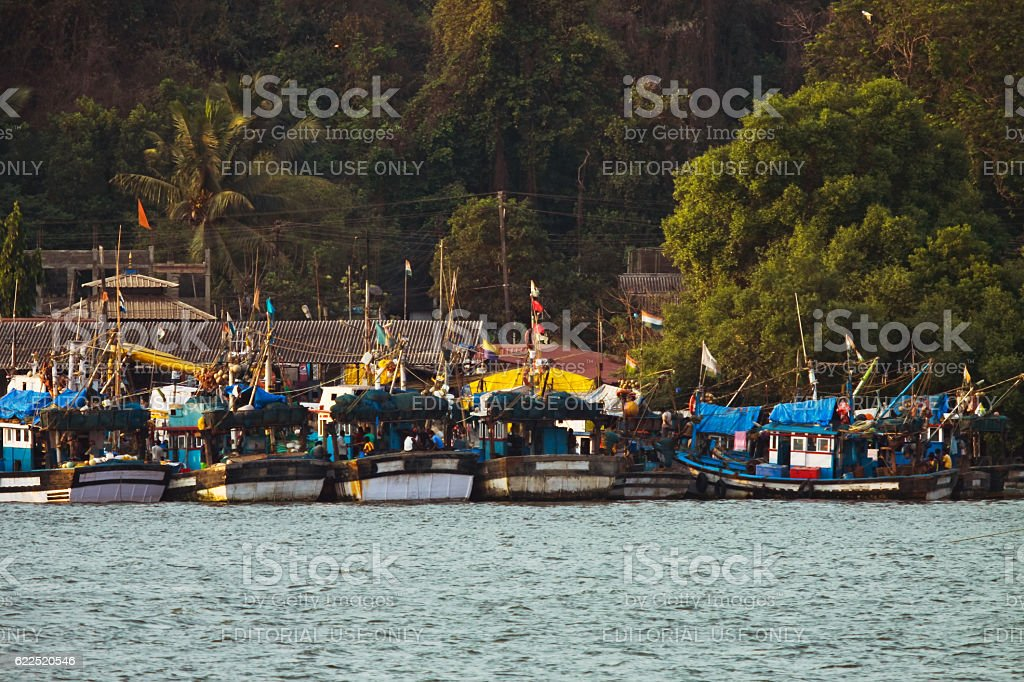 Fishing boat achored and tied together stock photo