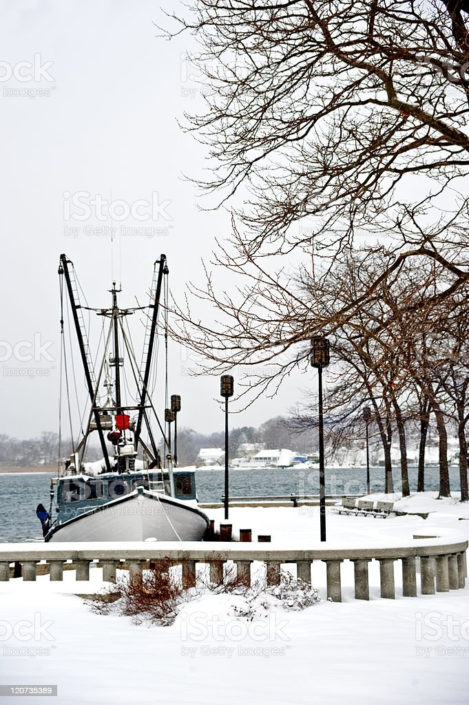 Fishing boat after snow storm stock photo