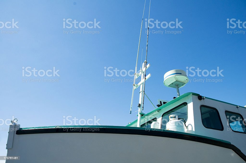 fishing boat against sky stock photo