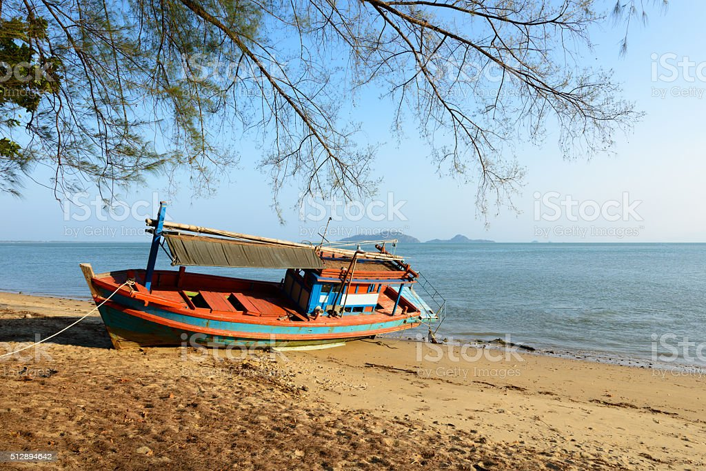 Fishing boat aground stock photo