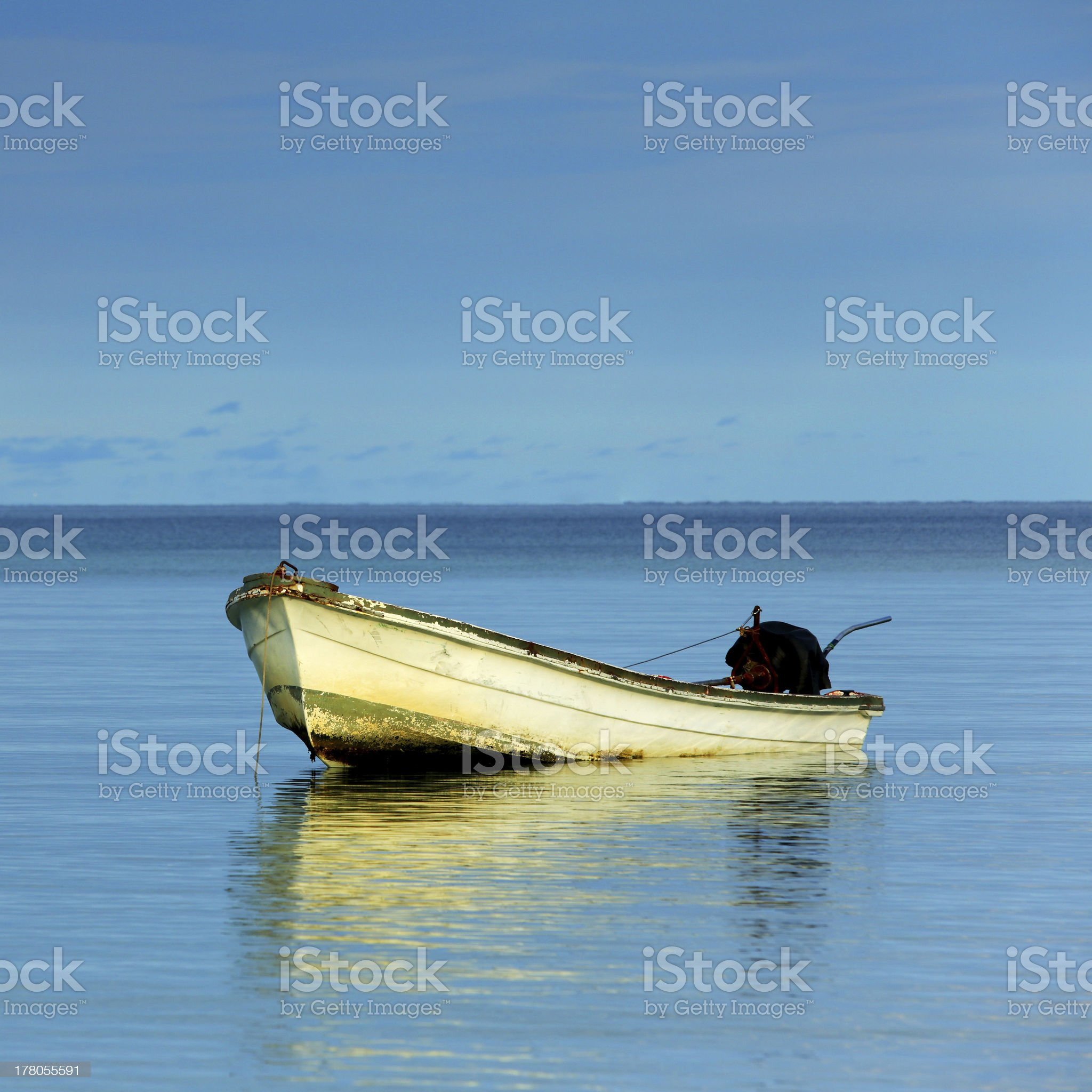 Fishing Boat Alone on Calm Morning Sea royalty-free stock photo
