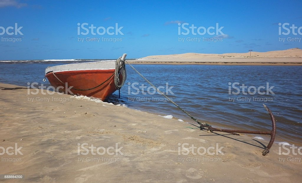 Fishing boat anchored on the shore stock photo