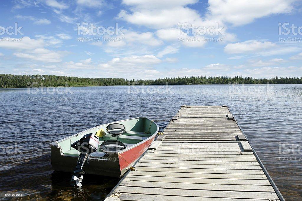XXL fishing boat and lake stock photo