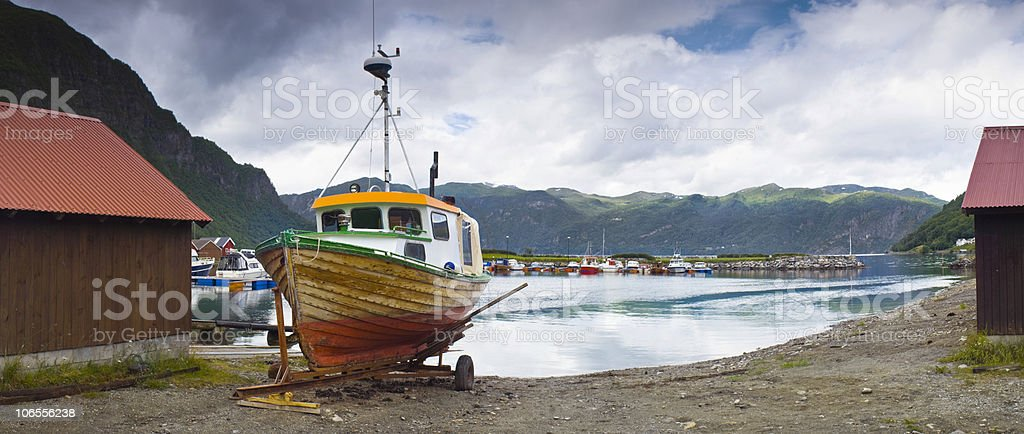 Fishing boat and mountains royalty-free stock photo