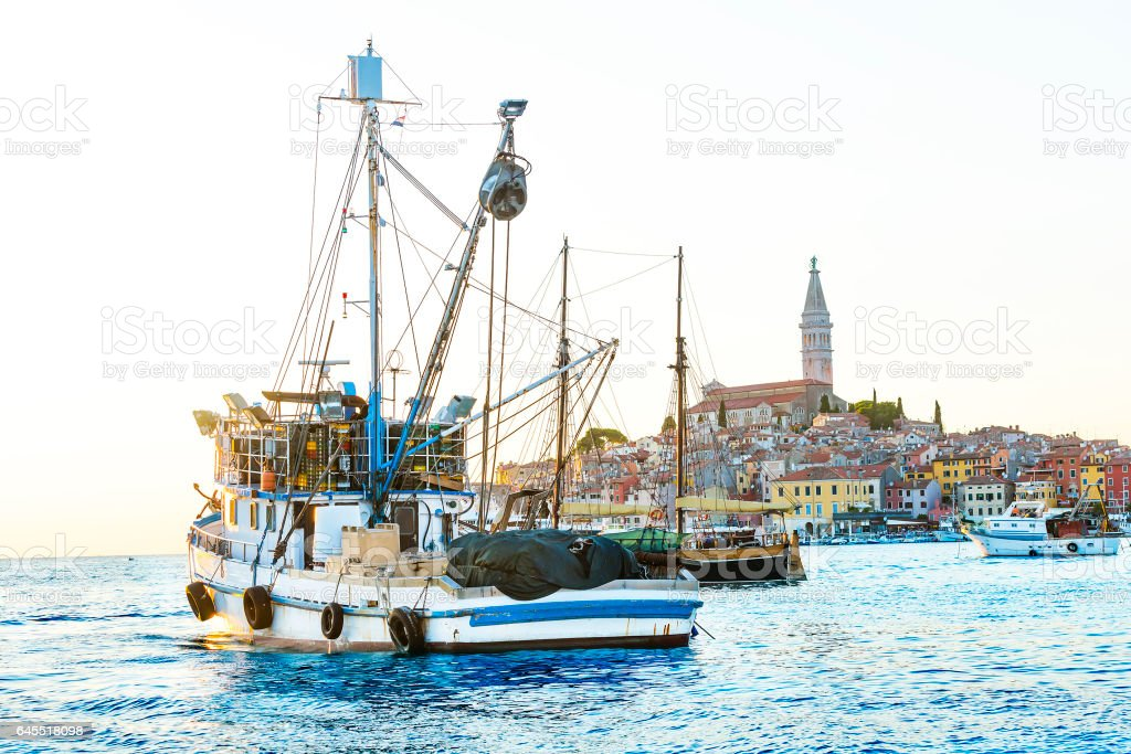 Fishing boat and old mediterranean town stock photo