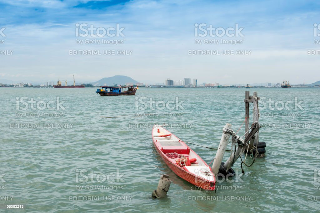Fishing boat and tanker by Penang state, Malaysia royalty-free stock photo