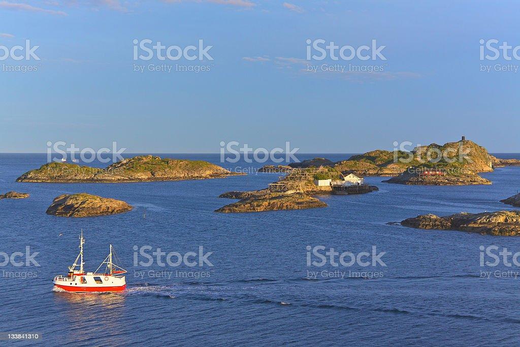 Fishing boat and tiny islets royalty-free stock photo