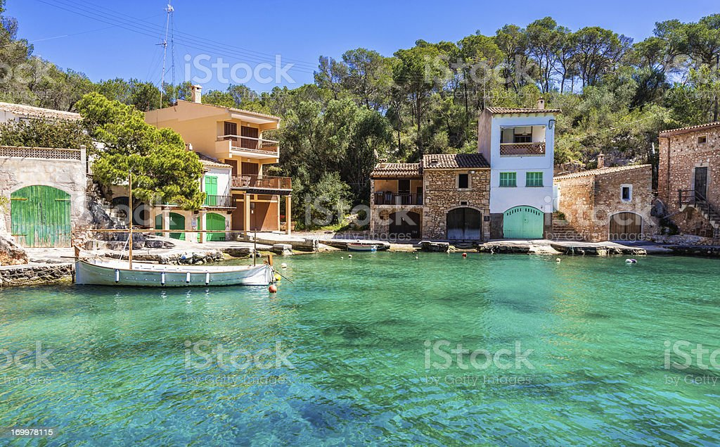 Fishing boat and traditional Majorcian houses in Cala Figuera royalty-free stock photo