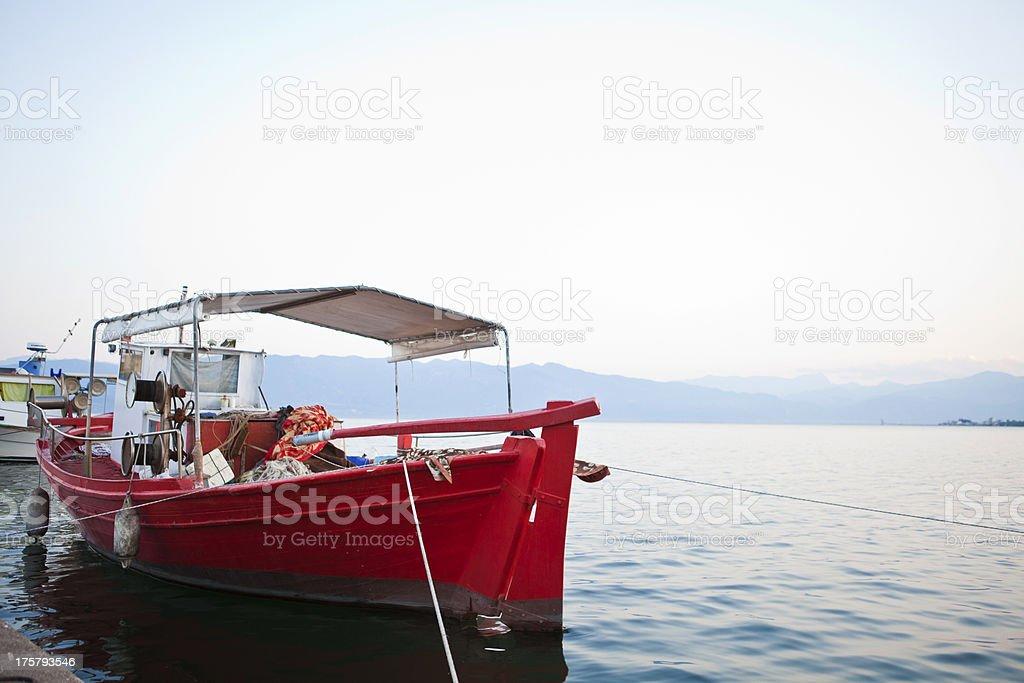 Fishing boat at a Greek harbor stock photo