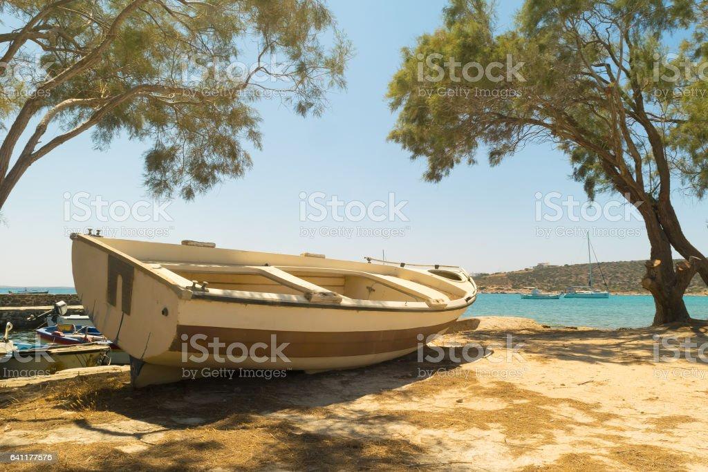 Fishing boat at Alyki beach at Paros island in Greece. stock photo