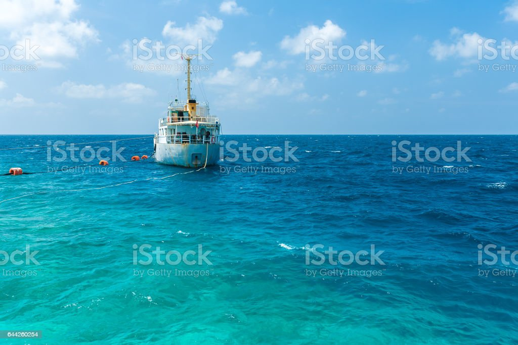 Fishing boat at anchor in the Indian ocean, Maldives stock photo