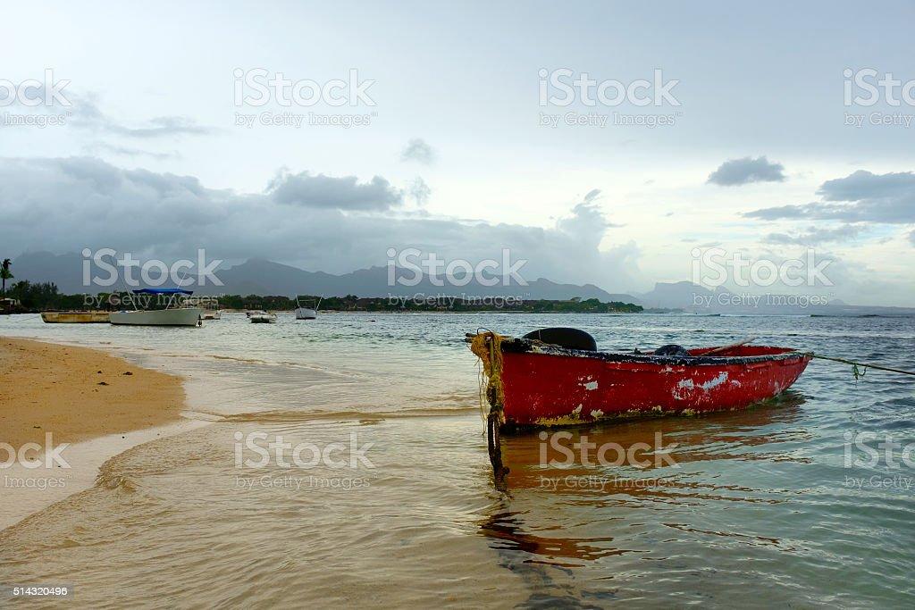 fishing boat at  beach - Mauritius stock photo