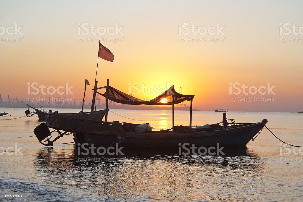 Fishing boat at dawn stock photo