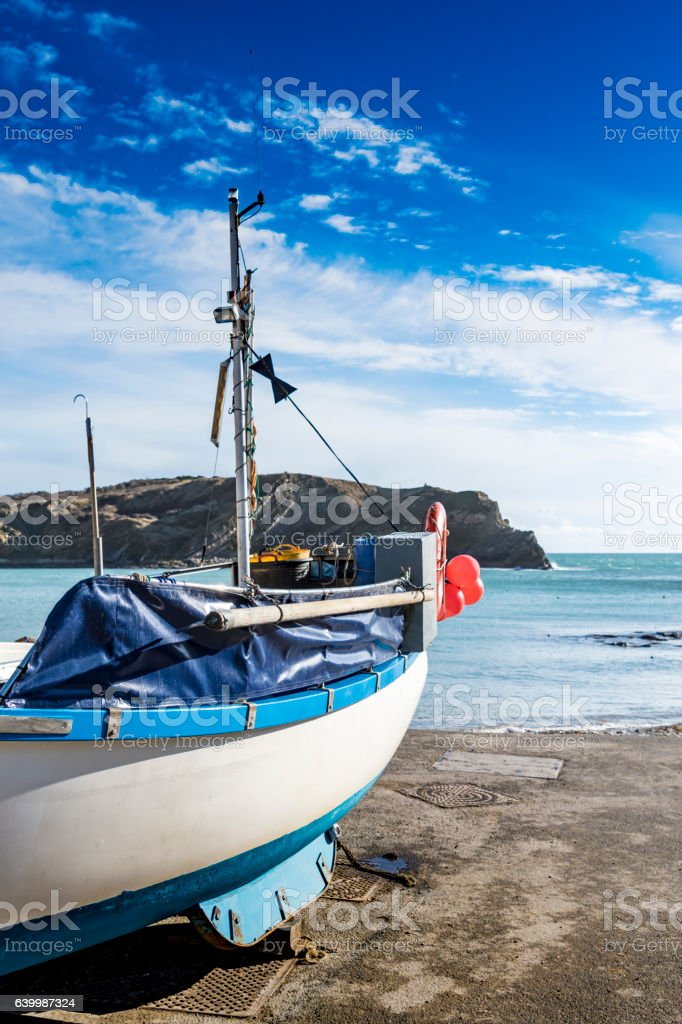 Fishing Boat at Lulworth Cove stock photo