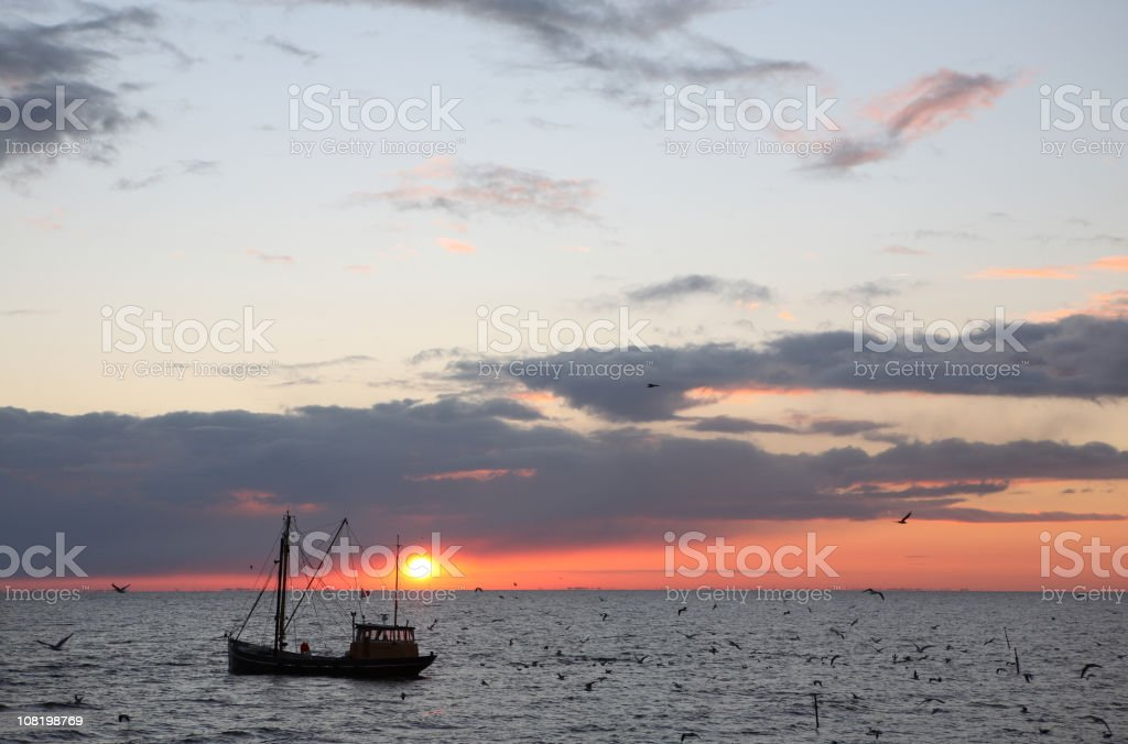 Fishing Boat At Sunrise royalty-free stock photo