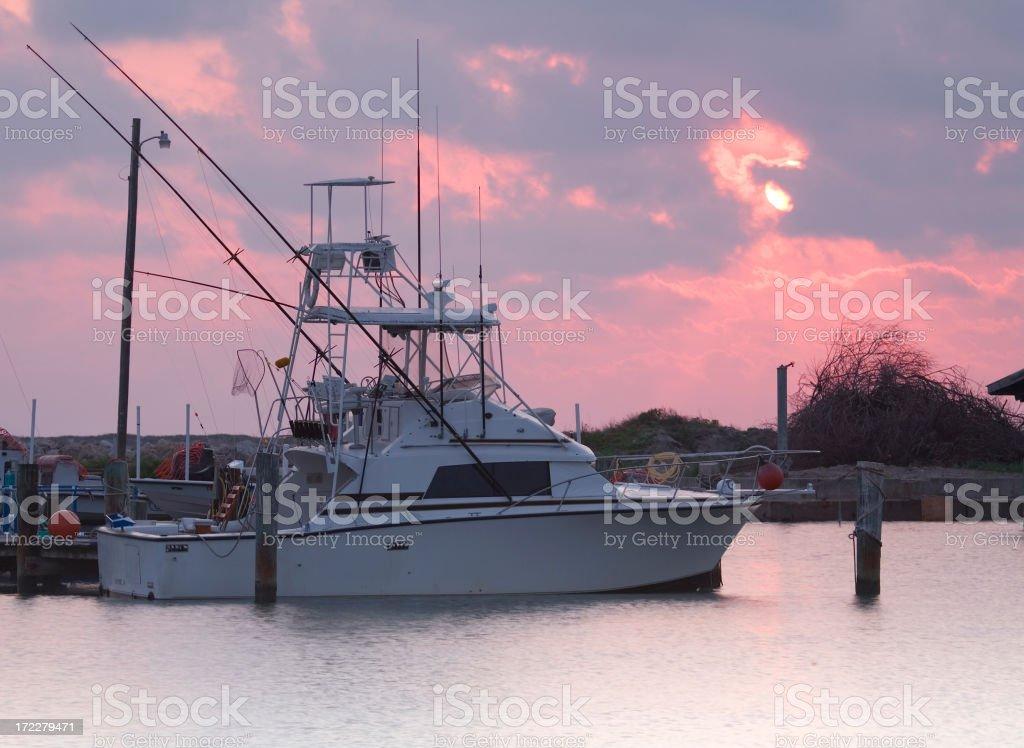 fishing boat at sunrise royalty-free stock photo
