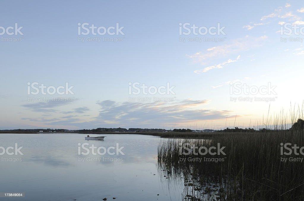 Fishing Boat at Sunrise stock photo
