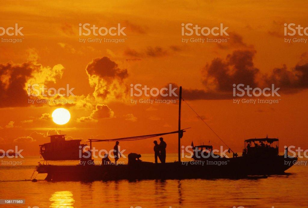 Fishing Boat At Sunset stock photo