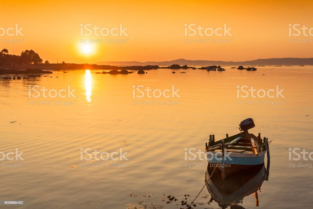 Fishing boat at sunset stock photo