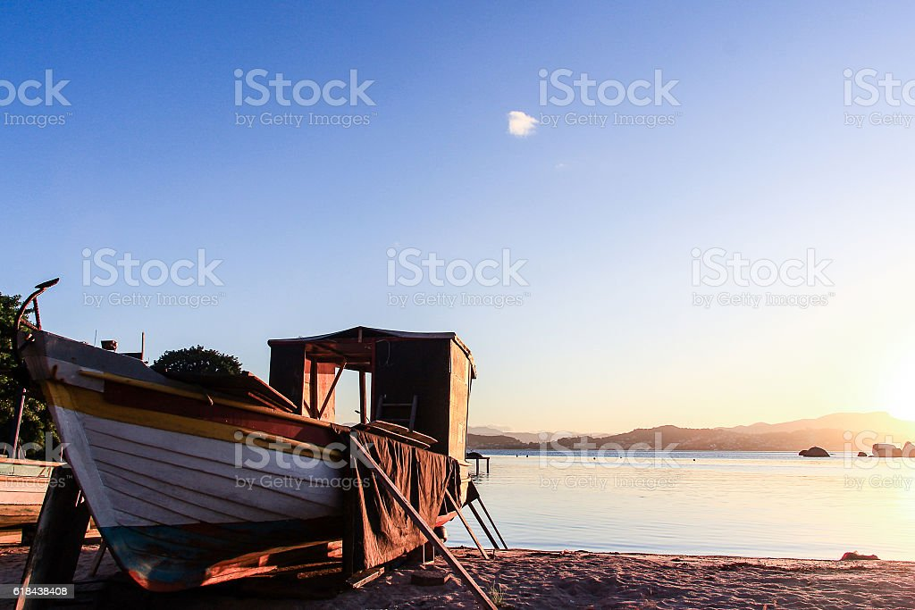 Fishing boat at the Abraao beach stock photo