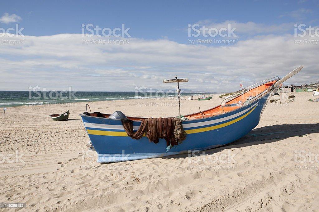 Fishing boat at the beach royalty-free stock photo