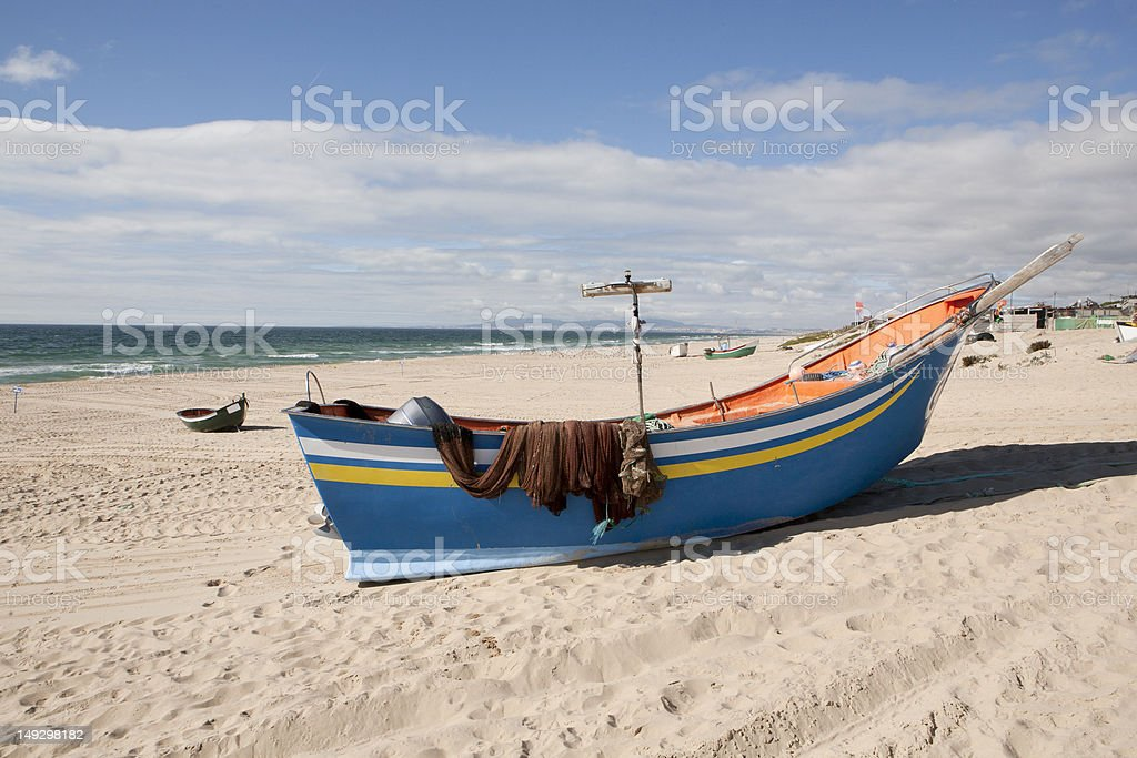 Fishing boat at the beach stock photo