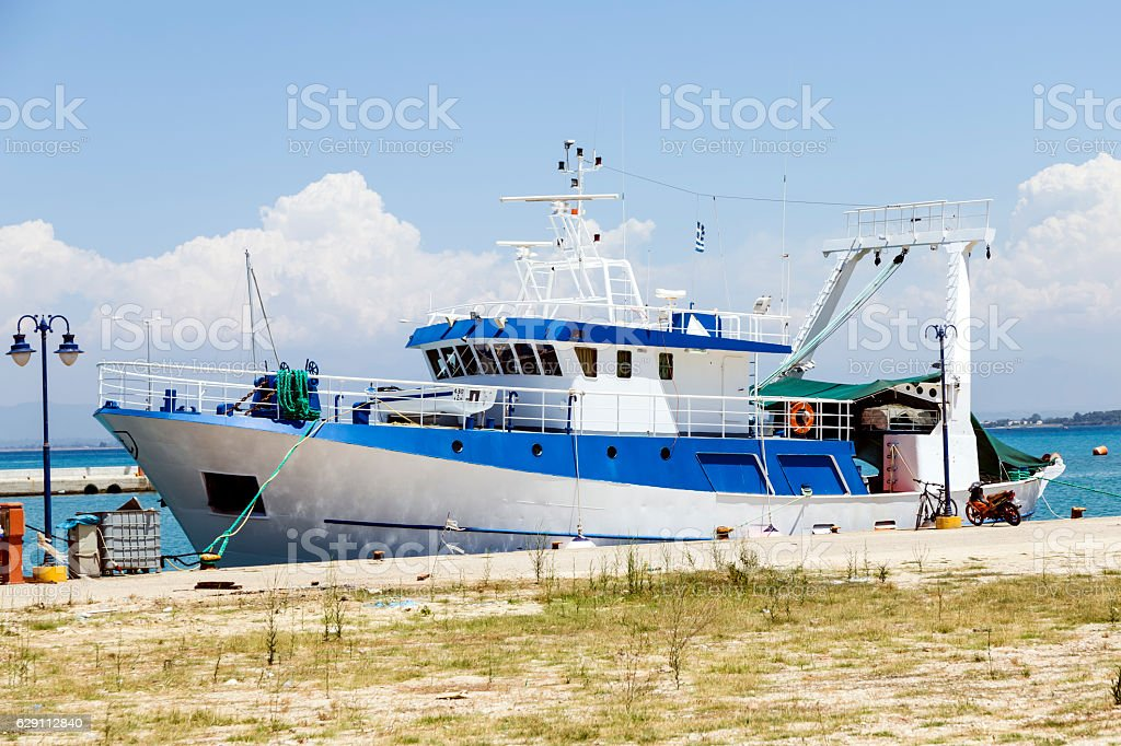 fishing boat at the pier stock photo