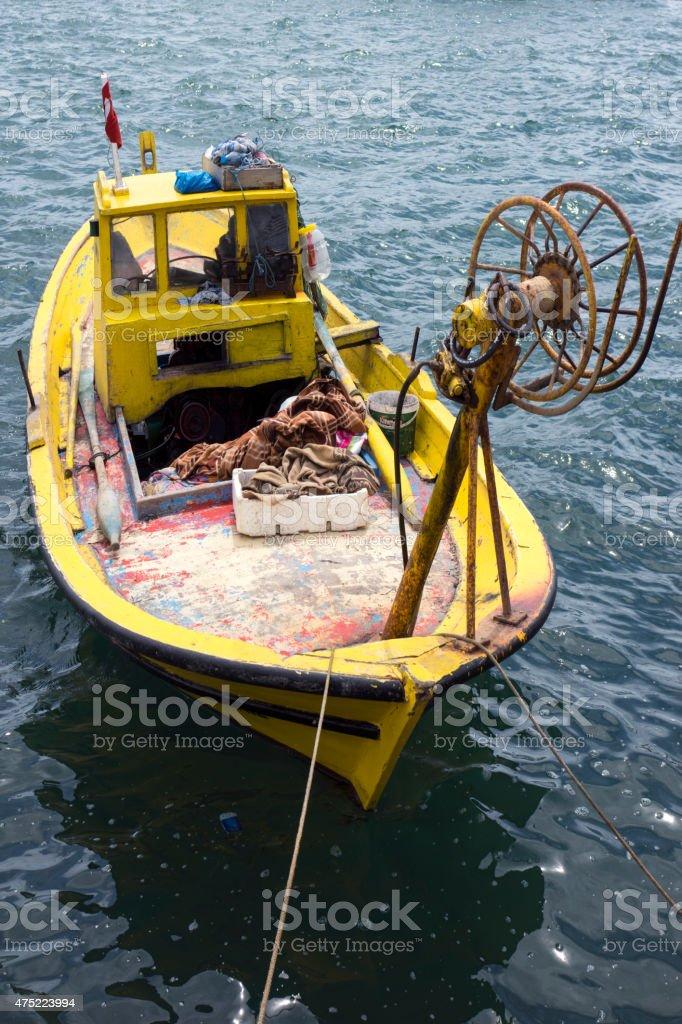 Fishing boat at the sea stock photo