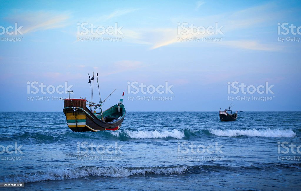 Fishing boat at the shore stock photo