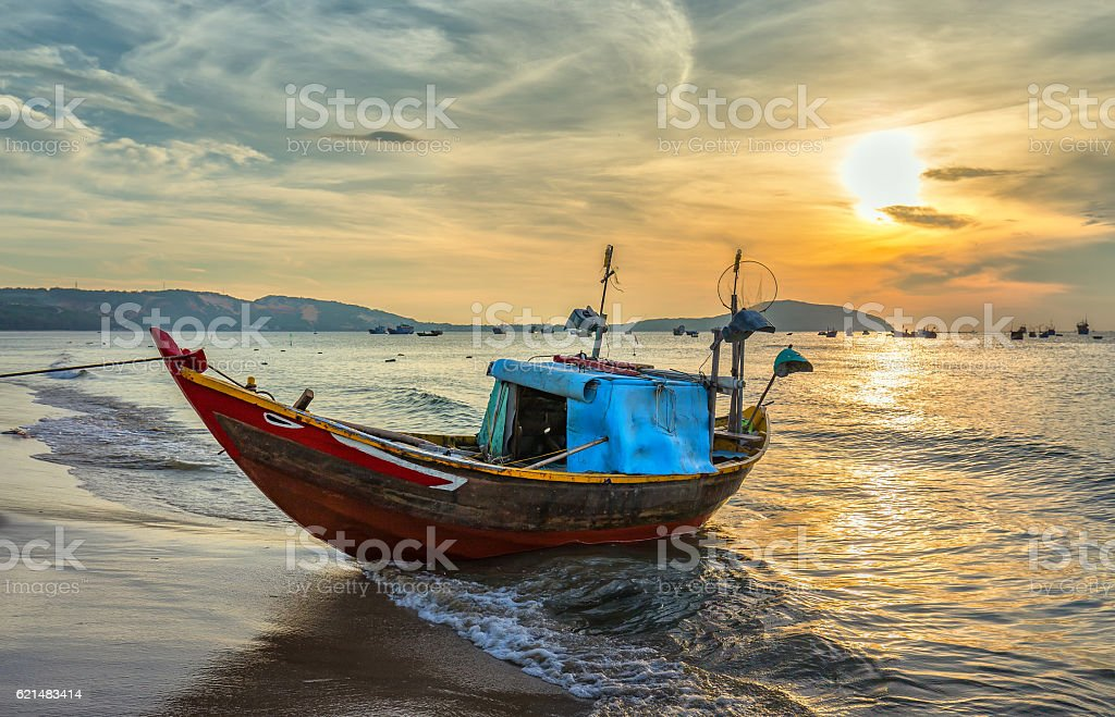 Fishing boat before dawn stock photo