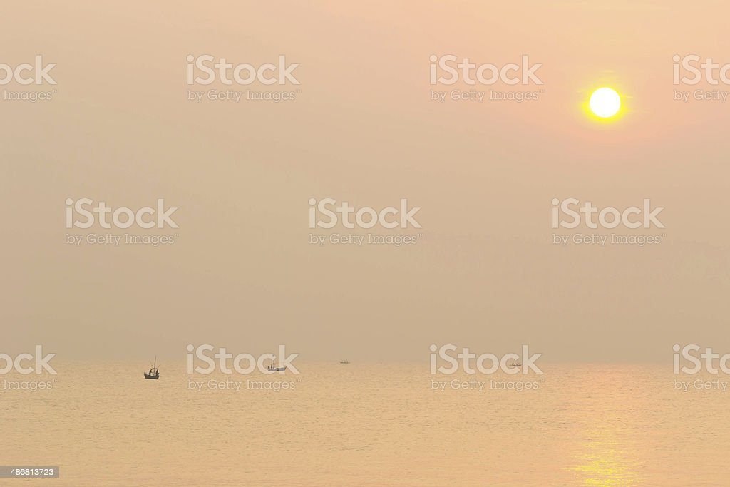Fishing boat begin work early in the morning royalty-free stock photo