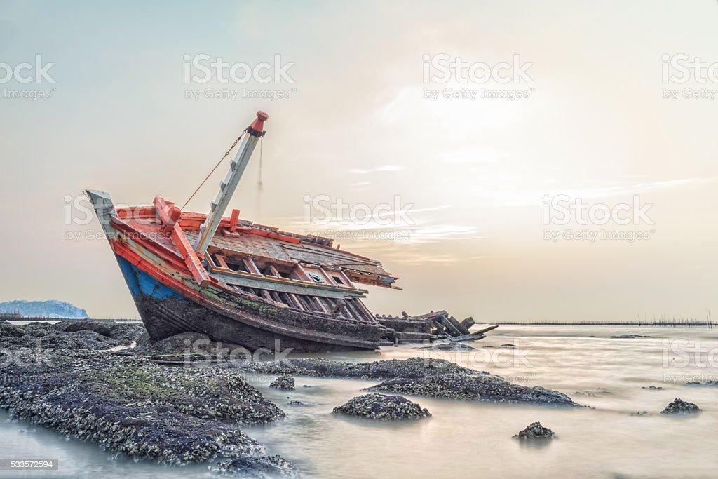 Fishing boat capsize at twilight blackground stock photo