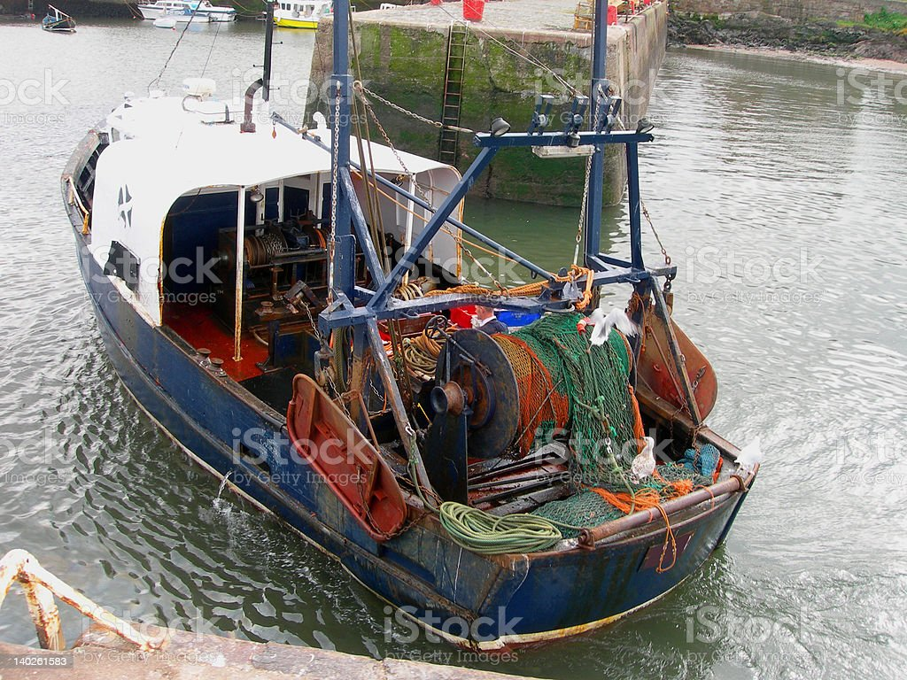 Fishing Boat Coming into Harbour royalty-free stock photo
