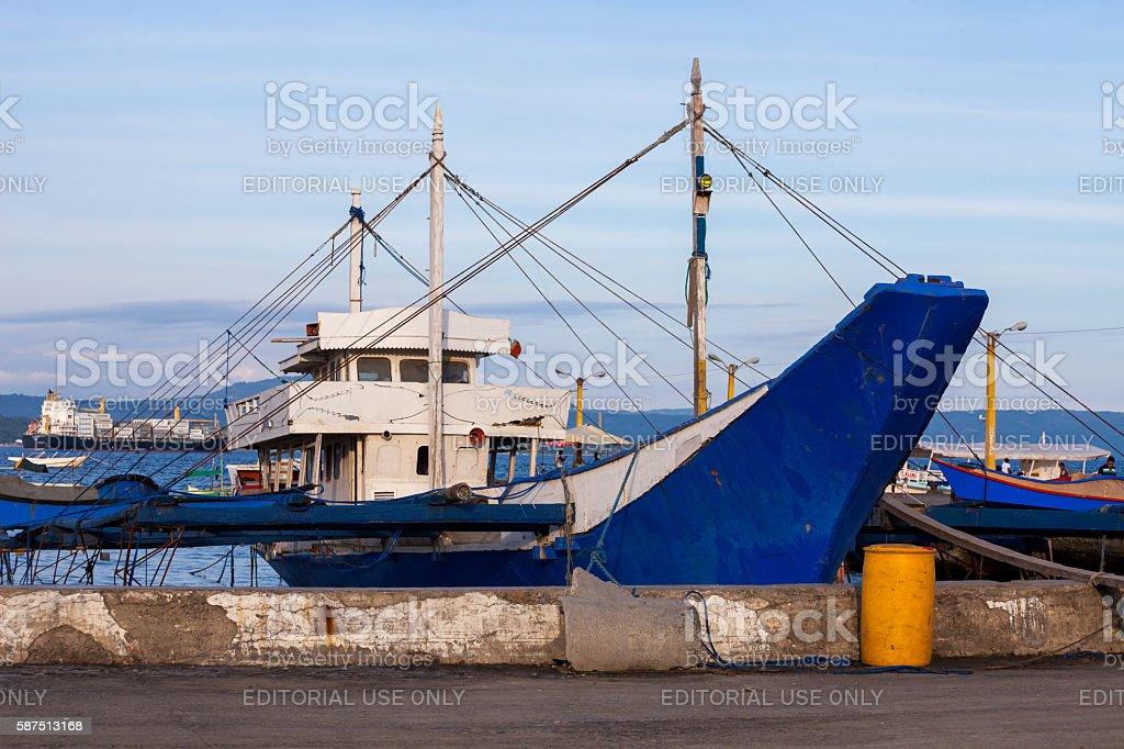 Fishing boat docked in Davao fish port stock photo