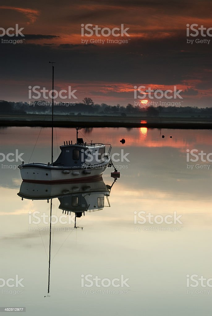 Fishing boat, early morning in the River Deben, Walderingfield, Suffolk stock photo