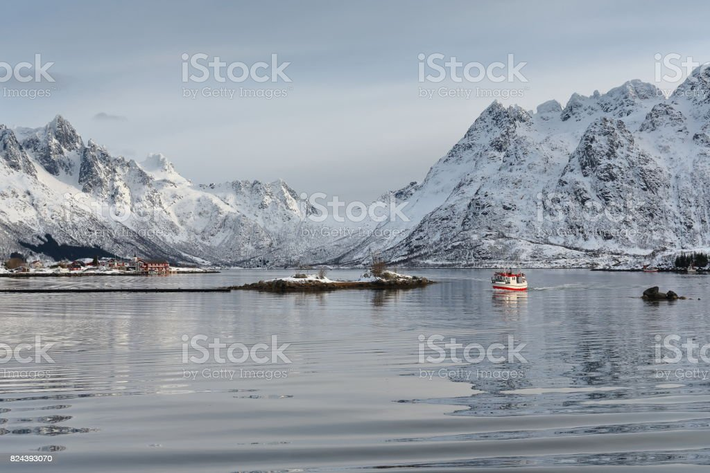 Fishing boat entering Sildpolltjonna bay from the east. Austnesfjorden-Austvagoya-Nordland-Norway. 0166 stock photo