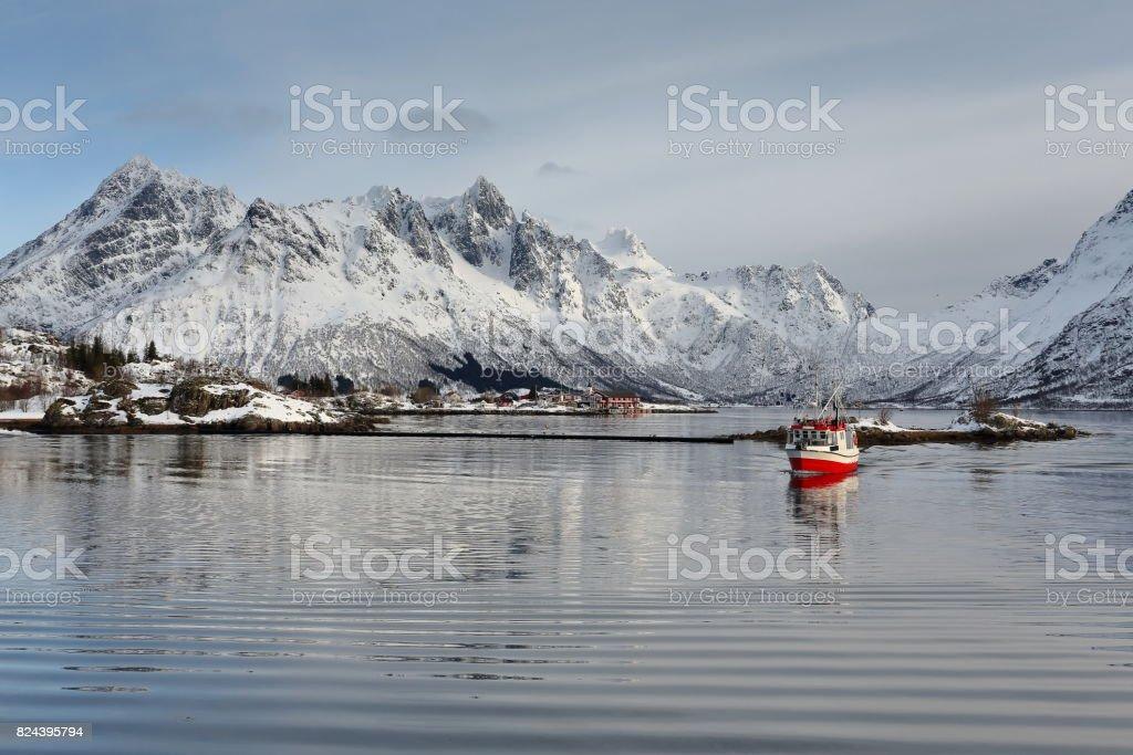 Fishing boat entering Sildpolltjonna bay from the east. Austnesfjorden-Austvagoya-Nordland-Norway. 0167 stock photo