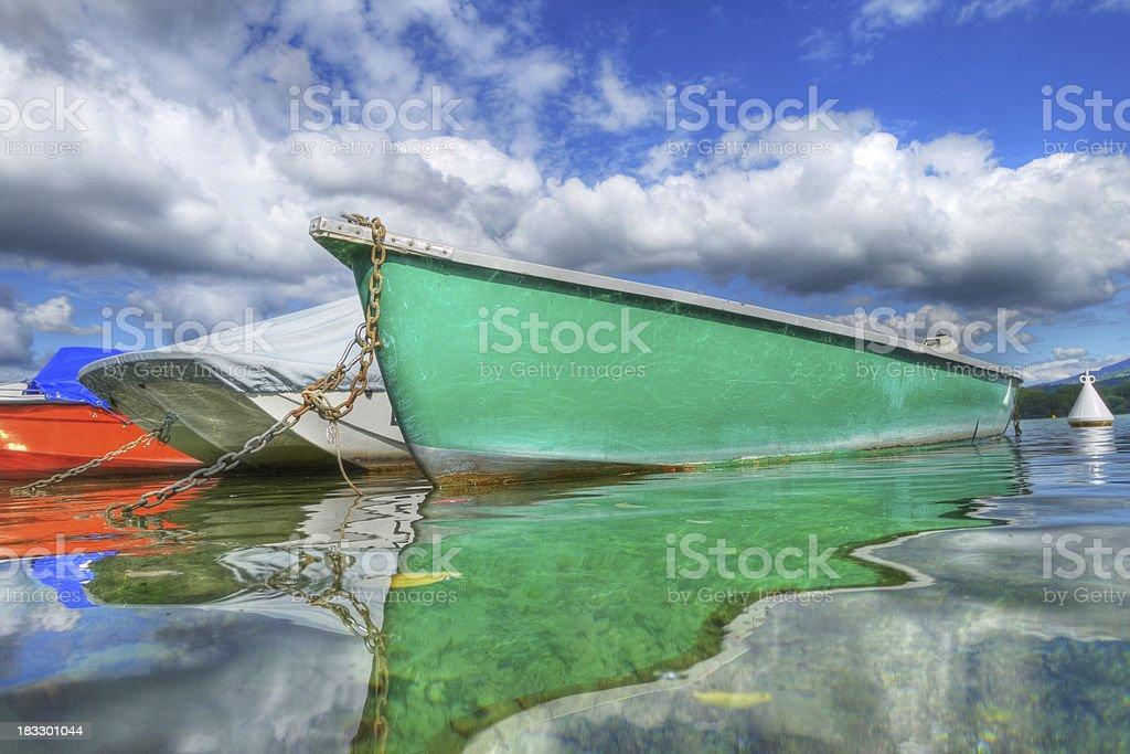 Fishing Boat Floating On Peaceful Lake - XLarge royalty-free stock photo