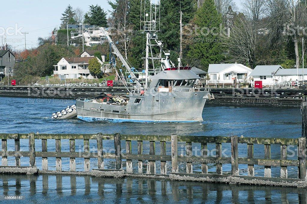 Fishing boat heading from Puget Sound into Ballard locks royalty-free stock photo