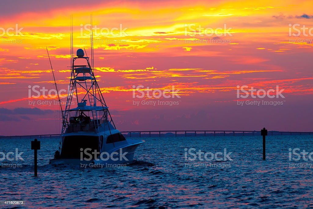 A fishing boat heading out for an early morning catch stock photo