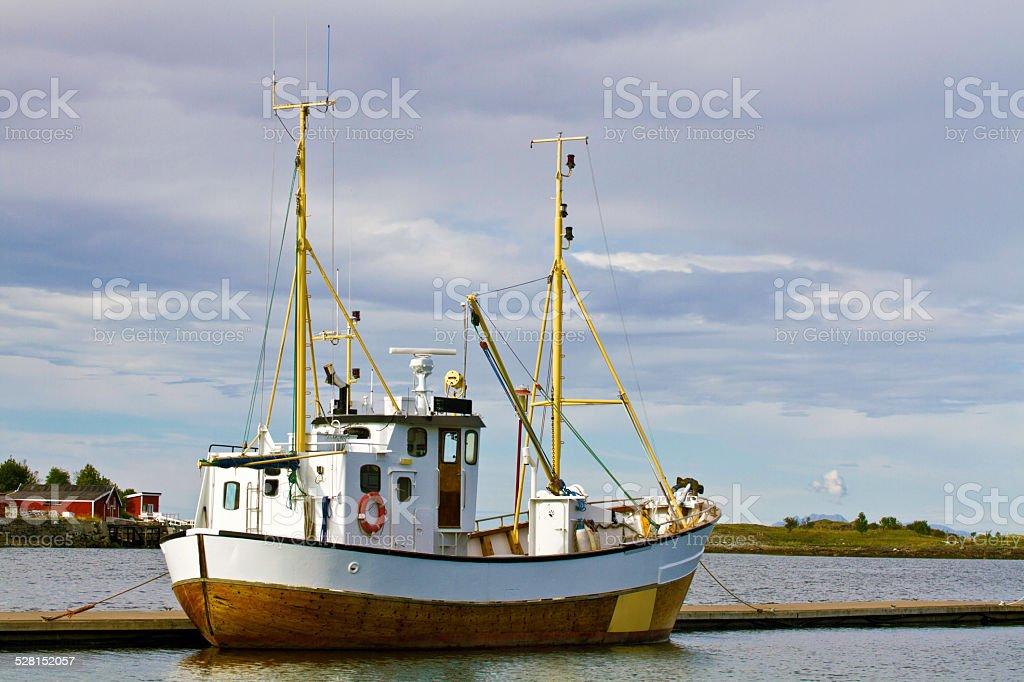 Fishing boat in  Bronnysund, Norway at dusk stock photo